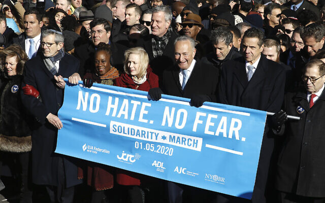 From right: Rep. Jerrold Nadler, Gov. Andrew Cuomo, Sen. Chuck Schumer, Mayor Bill de Blasio and Sen. Kirsten Gillibrand hold a banner at the march against anti-Semitism in New York City, Jan. 5, 2020. (John Lamparski/Echoes Wire/Barcroft Media via Getty Images/via JTA)