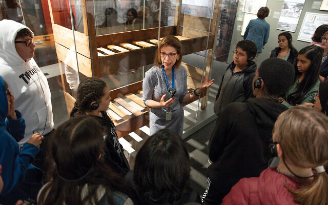 "A class of eighth graders tours the ""Auschwitz"" exhibition at the Museum of Jewish Heritage in Battery Park City. Photos by Museum of Jewish Heritage/John Halpern"