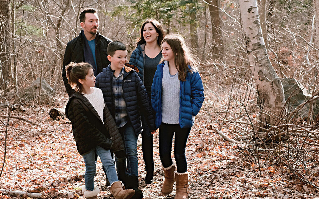 """""""I saw a child who was receding into the darkness come to life,"""" Mimi Lemay, shown with her family, says of her transgender child. Photos by Kelly Lorenz"""