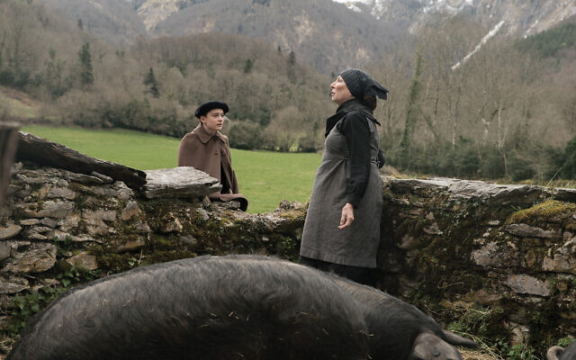"Noah Schnapp, Anjelica Huston in ""Waiting for Anya."" Vertical Entertainment"