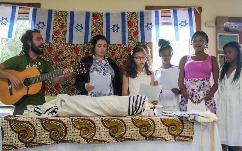 The Be'chol Lashon organization promotes ethnic diversity within the Jewish community, including holding a summer camp for Jewish kids from diverse backgrounds, like this group celebrating Shabbat in 2016. (Courtesy Be'chol Lashon/via Times of Israel)