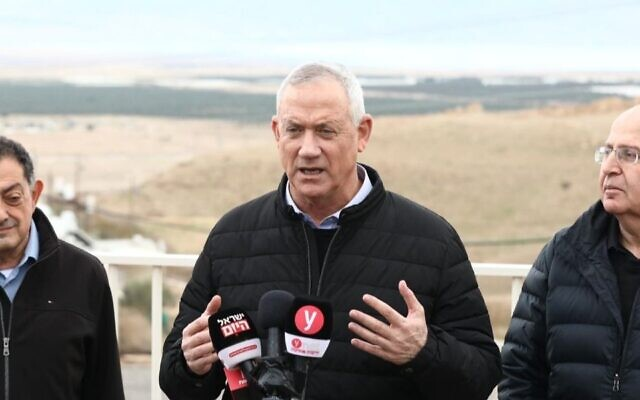 Blue and White Chairman Benny Gantz, flanked by former Defense Minister Moshe Yaalon, right, and Megilot Dead Sea Regional Council head Aryeh Cohen, tells reporters that he will work to annex the Jordan Valley after upcoming national elections, Jan. 21, 2020. (Elad Malka/via JTA)