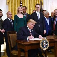 US President Donald Trump signs an Executive Order to further the fight against the rise of anti-Semitism. BRENDAN SMIALOWSKI/AFP via Getty Images