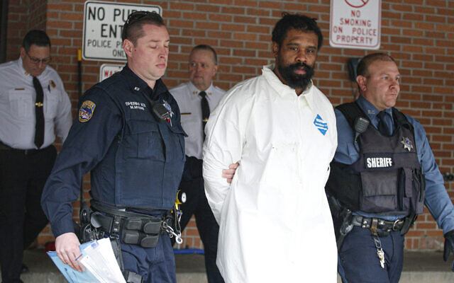 Suspect in Hanukkah celebration stabbings Thomas Grafton, 37 years old from Greenwood Lake, leaves the Ramapo Town Hall in Airmont, New York after being arrested on December 29, 2019.(Kena Betancur / AFP / via JTA)