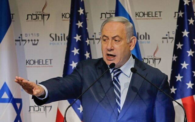 "Isreali Prime Minister Benjamin Netanyahu speaks at the Kohelet Policy Forum conference in Jerusalem, on January 8, 2020. - Netanyahu today warned Israel would strike a ""resounding blow"" if attacked by arch foe Iran, as regional tensions spike after the US killing of military commander Qasem Soleimani. (Photo by Menahem KAHANA / AFP) (Photo by MENAHEM KAHANA/AFP via Getty Images)"