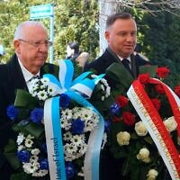Polish President Andrzej Duda (R) and Israel's President Reuven Rivlin arrive for a wreath laying ceremony at the monument of Polish Auschwitz hero Witold Pilecki during ceremonies to commemorate the 75th anniversary of the former Nazi death camp's liberation in Oswiecim, Poland, on January 27, 2020. - More than 200 survivors are to come from across the globe to the camp the Nazis built in Oswiecim in then-occupied Poland, to share their testimony as a stark warning amid a recent surge of anti-semitic attacks on both sides of the Atlantic. (Photo by JANEK SKARZYNSKI / AFP) (Photo by JANEK SKARZYNSKI/AFP via Getty Images)