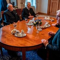 German President Frank-Walter Steinmeier (R) sits with Holocaust survivors (from L) Pavel Taussig, Peter Gardosch, and Herman Hoellenreiner at the presidential Bellevue palace in Berlin on January 27, 2020. - Steinmeier will travel with the three survivors to the Auschwitz-Birkenau concentration camp in Poland where they will attend ceremonies marking the 75th anniversary of the liberation by Soviet troops of the complex. (Photo by John MACDOUGALL / AFP) (Photo by JOHN MACDOUGALL/AFP via Getty Images)