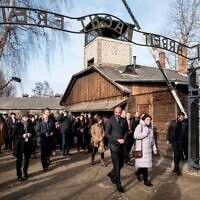 "French Prime Minister Edouard Philippe (C) walks through the gate with the inscription ""Work sets you free"" (Arbeit macht frei) as he visits the memorial site of the former German Nazi death camp Auschwitz during ceremonies to commemorate the 75th anniversary of the camp's liberation in Oswiecim, Poland, on January 27, 2020. - More than 200 survivors are to come from across the globe to the camp the Nazis built in Oswiecim in then-occupied Poland, to share their testimony as a stark warning amid a recent surge of anti-semitic attacks on both sides of the Atlantic. (Photo by Wojtek RADWANSKI / AFP) (Photo by WOJTEK RADWANSKI/AFP via Getty Images)"