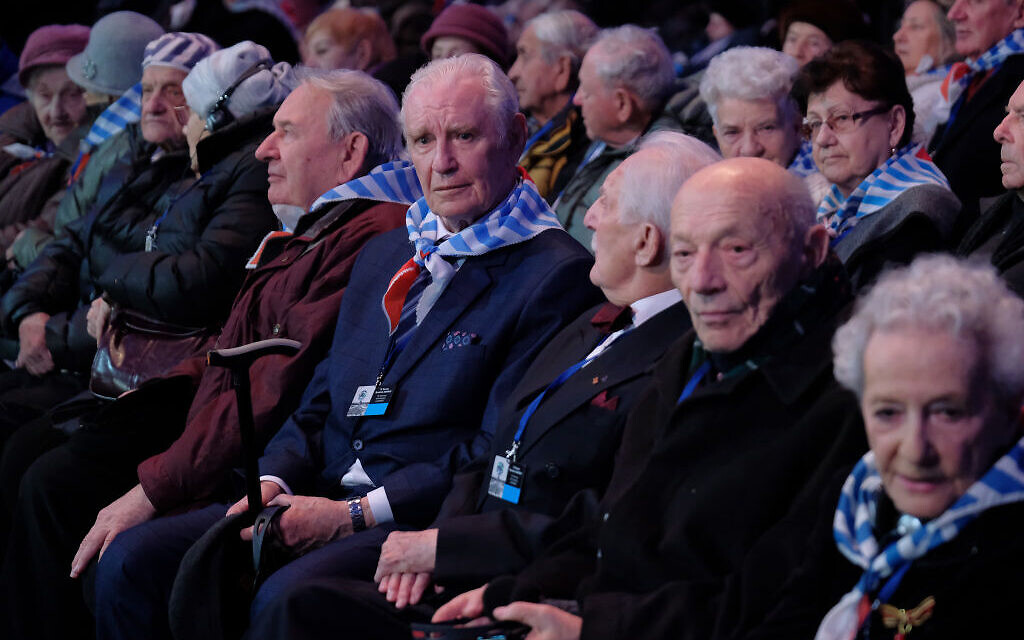Auschwitz concentration camp survivors and their families attend the official ceremony to mark the 75th anniversary of the liberation of the Auschwitz concentration camp at the Auschwitz-Birkenau site on January 27, 2020 near Oswiecim, Poland. Photo by Sean Gallup/Getty Images