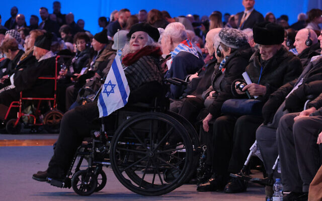 OSWIECIM, POLAND - JANUARY 27: Auschwitz concentration camp survivors and their families attend the official ceremony to mark the 75th anniversary of the liberation of the Auschwitz concentration camp at the Auschwitz-Birkenau site on January 27, 2020 near Oswiecim, Poland. International leaders as well as approximately 200 survivors and their families are gathering today at Auschwitz today to attend the commemoration. The Nazis killed an estimated one million people at the camp during the World War II occupation of Poland by Nazi Germany. The Soviet Army liberated the camp on January 27, 1945.   (Photo by Sean Gallup/Getty Images)
