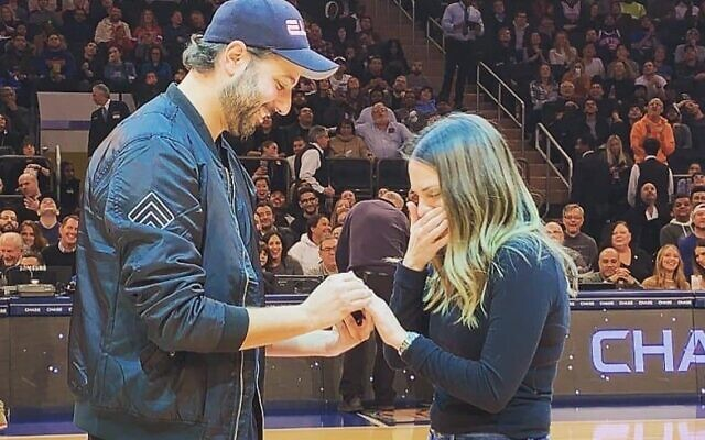 Eli Lunzer popped the question to girlfriend Yosefa Heber in front of about nearly 20,000 people at Madison Square Garden. Courtesy
