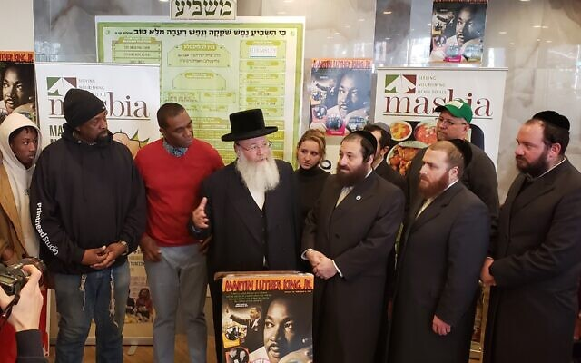 Yosef Rapaport, a community activist, speaks at a Martin Luther King Jr. Day event at the Masbia soup kitchen in Brooklyn. (Courtesy of Masbia/via JTA)