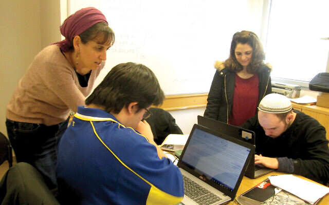 Students in Bar-Ilan University's master's program in intellectual disability help bachelor's students with ID in a writing course. Michele Chabin/JW