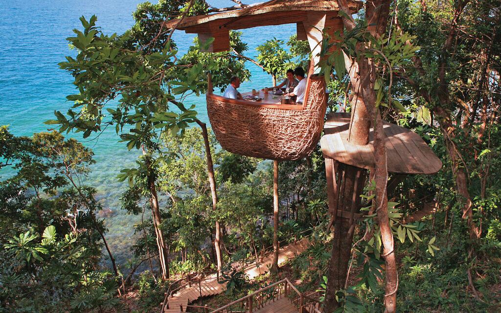 Treetop dining at the Soneva Kiri on Thailand's rainforest-covered Ko Kud Islands.