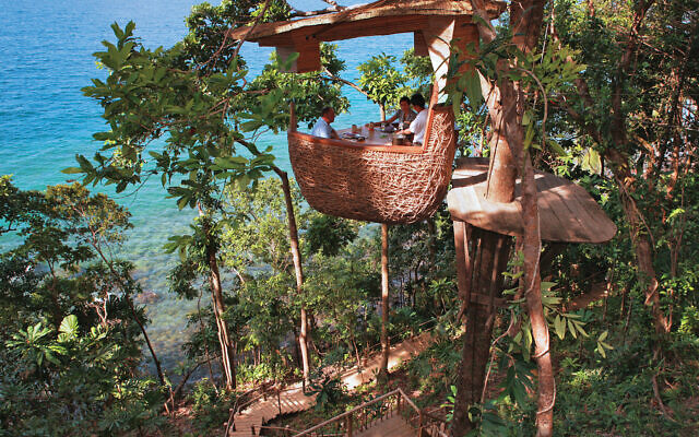 Treetop dining at the Soneva Kiri on Thailand's rainforest-covered Ko Kud Islands.