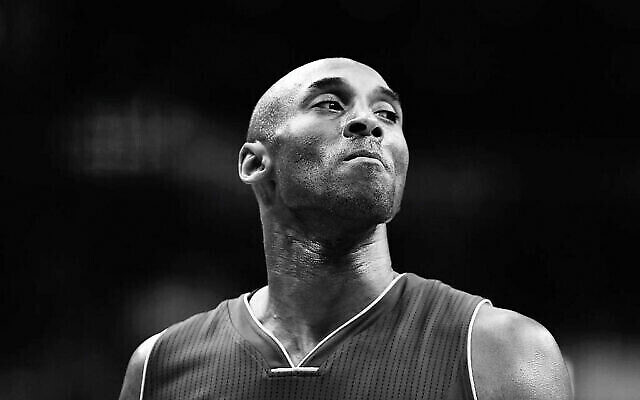 Kobe Bryant #24 of the Los Angeles Lakers looks on against the Washington Wizards in the first half at Verizon Center on December 2, 2015 in Washington, DC.  Rob Carr/Getty Images