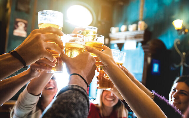 """Glass half empty: """"Maybe we can think twice when alcohol is served in excess at Jewish organizational functions and kiddushes as a centerpiece and a staple,."""" the author writes."""