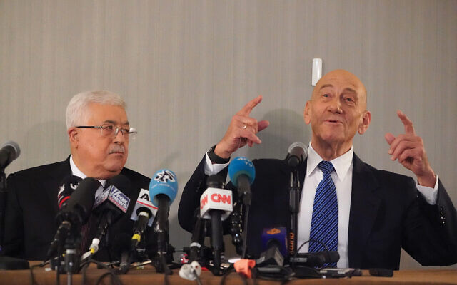 Mahmoud Abbas and Ehud Olmert in a joint press conference here Tuesday. The two called President Trump's recently unveiled Mideast peace plan flawed. Getty Images