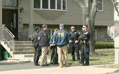 FBI agents and police officers conducted a series of raids in Ramapo, N.Y., stemming from a probe of irregularities in the federal E-rate program, which is designed to help schools access technology. Screenshot from YouTube