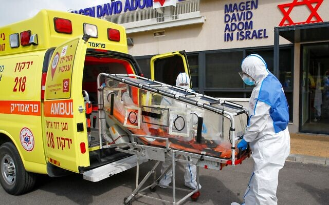 Israeli Paramedics of Maguen David Adom (Israel's National Emergency Pre-Hospital Medical Organisation) at the coronavirus national operations center unload a containment chamber during a coronavirus response training exercise in the central Israeli city of Kiryat Ono on February 26, 2020. - Photo by JACK GUEZ/AFP via Getty Images