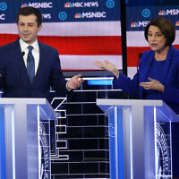 LAS VEGAS, NEVADA - FEBRUARY 19: Democratic presidential candidate former South Bend, Indiana Mayor Pete Buttigieg (L) and Sen. Amy Klobuchar (D-MN) participate in the Democratic presidential primary debate at Paris Las Vegas on February 19, 2020 in Las Vegas, Nevada. Six candidates qualified for the third Democratic presidential primary debate of 2020, which comes just days before the Nevada caucuses on February 22. (Photo by Mario Tama/Getty Images)