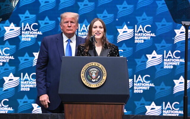 Adela Cojab on stage with US President Donald Trump during the 2019 Israeli-American Council National Summit in Florida, December 2019. (Noam Galai/via Times of Israel)