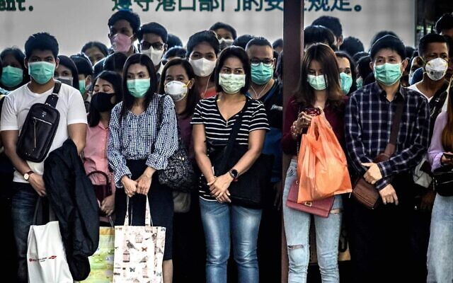 Commuters with protective face masks in Bangkok, Thailand, to protect from the coronavirus, Jan. 30, 2020. (Mladen Antonov/AFP via Getty Images/via JTA)