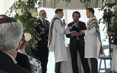 Rabbi Avram Mlotek, center, performs his first same-sex wedding, February 2020. (Courtesy of Mlotek/via JTA)