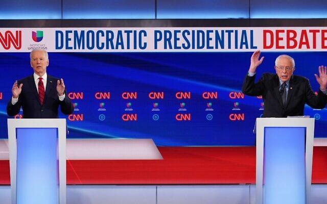 Democratic presidential hopefuls former US vice president Joe Biden (L) and Vermont Senator Bernie Sanders (R) take part in the 11th Democratic Party 2020 presidential debate in a CNN Washington Bureau studio in Washington, DC on March 15, 2020. (MANDEL NGAN/AFP via Getty Images/via JTA)