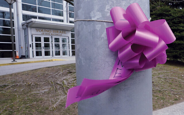 Loss of connection: A ribbon tied to a tree outside the Young Israel of New Rochelle, the first synagogue in the coronovirus outbreak. Getty Images