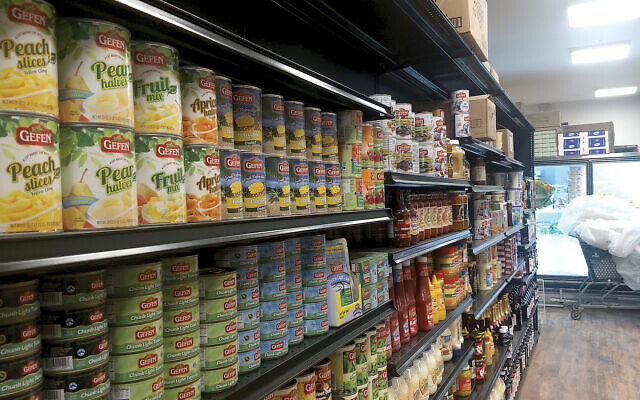 Some of JC Kosher's shelves are fully stocked with staples in its new location, two blocks away from the original store.  Ben Sales