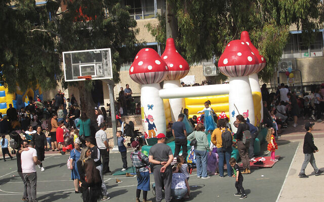 Despite the Coronavirus threat, life in Israel is going on pretty much normally. Large events have been banned, but smaller events, such as this local Purim festival, are permitted. Michele Chabin/JWt