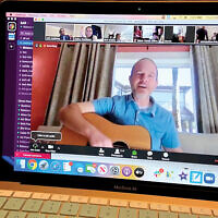 Distance learning: One of SAR's Zoom sessions last Thursday morning included guitar music. Courtesy of SAR Academy
