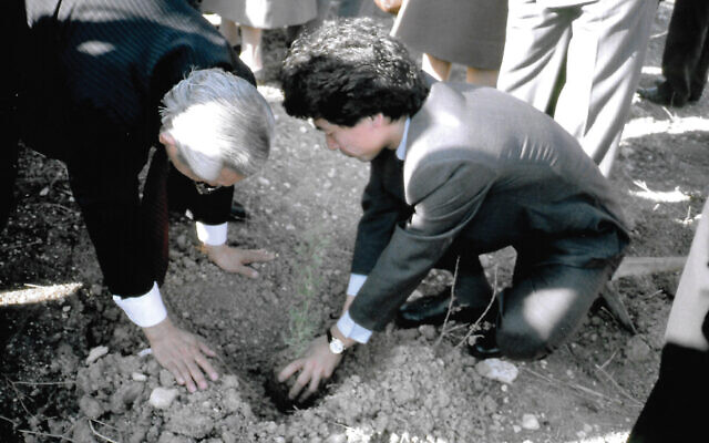 Nobuki Sugihara, right, the son of Righteous Gentile Chiune Sugihara, planting the first seedling in the forest named for his father. Photos courtesy of Nobuki Sugihara