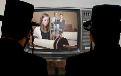 "Charedi Orthodox Jews enjoy an episode of ""Shtickl,"" a Netflix series about a Reform Jewish family. Janice Hwang / JW"