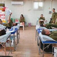 IDF soldiers donate blood  in partnership with Magen David Adom, in  an effort to boost blood supplies during the coronavirus outbreak.  (Israel Defense Forces)