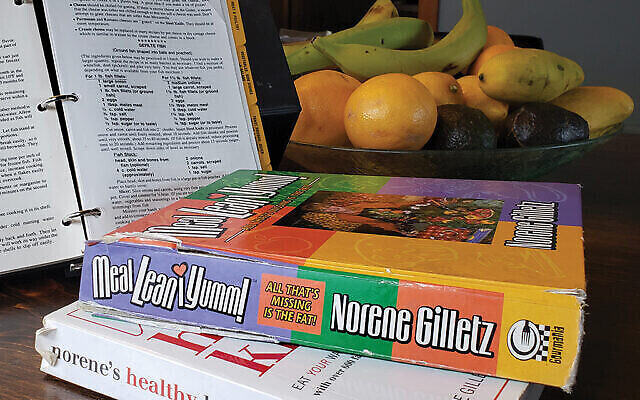 """The author's collection of Norene Gilletz cookbooks, including """"the yellow one"""" with the binder that turns into a cookbook stand. Photo by Jonathan Fox"""