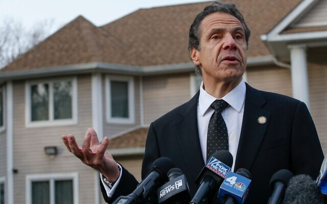 New York Gov. Andrew Cuomo talks to reporters outside the home of Rabbi Chaim Rottenberg in Monsey, N.Y., Dec. 29, 2019. Cuomo was speaking the morning after a stabbing attack at the rabbi's home injured five -- one would die of his wounds. (Kena Betancur/AFP via Getty Images/via JTA)