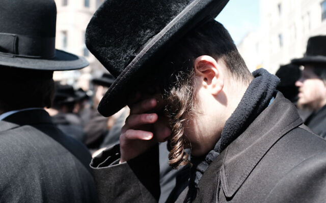 A Hasidic Jew at a funeral in the Brooklyn neighborhood of Borough Park in 2019. (Spencer Platt/Getty Images/via JTA)