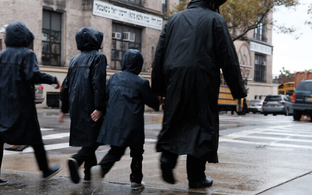 Members of the Jewish Orthodox community walk through a Brooklyn neighborhood on the Yom Kippur holiday, Oct. 9, 2019. (Spencer Platt/Getty Images)