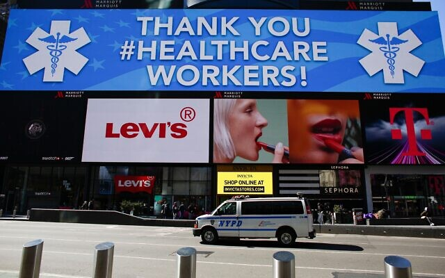 A sign in Times Square thanking healthcare workers in Times Square. KENA BETANCUR/AFP via Getty Images