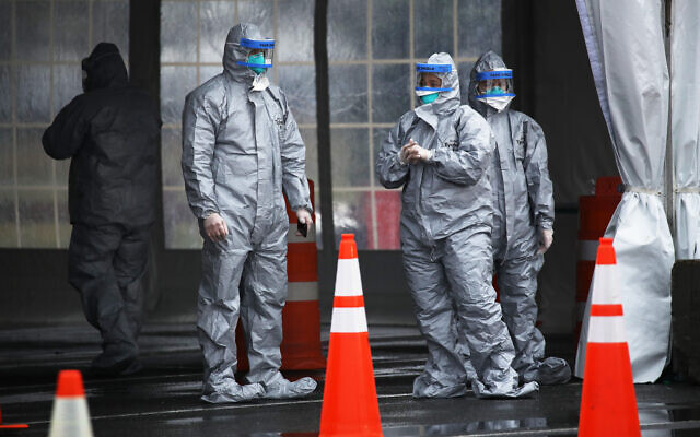 NEW ROCHELLE, NEW YORK - MARCH 13: Workers in protective gear operate a drive through COVID-19 mobile testing center on March 13, 2020 in New Rochelle, New York. (Getty Images)
