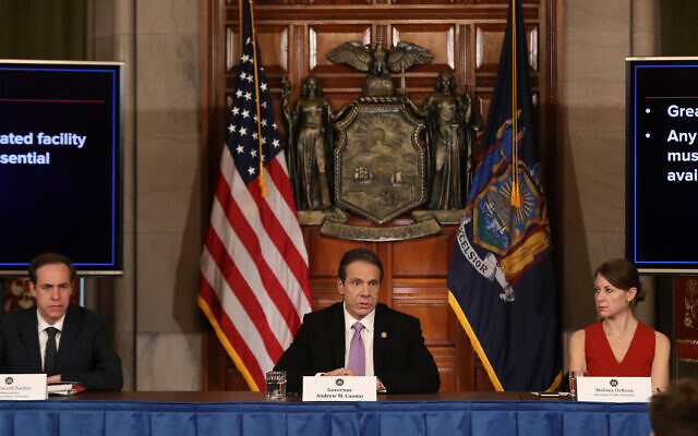 (L-R) New York State Heath Commissioner Howard A. Zucker, M.D., J.D., New York Governor Andrew Cuomo, and Secretary to the Governor Melissa DeRosa attend the Governor's daily news conference amid the coronavirus outbreak on March 20, 2020 in New York City. Bennett Raglin/Getty Images