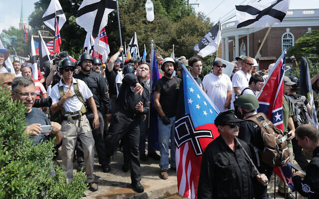 "Hundreds of white nationalists, neo-Nazis, KKK and members of the ""alt-right"" hurl water bottles back and forth against counter demonstrators on the outskirts of Emancipation Park during the Unite the Right rally August 12, 2017 in Charlottesville, Virginia. Chip Somodevilla/Getty Images"