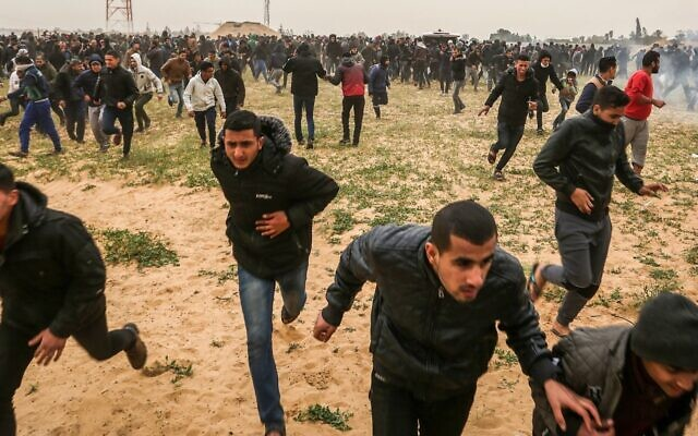 Palestinian protesters take part in a demonstration marking the one-year anniversary of the March of Return near the Israel-Gaza border, March 30, 2019. (Abed Rahim Khatib/Flash90/via JTA)