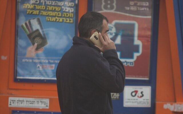 A man speaks on the cellphone in Jerusalem. Israel's Supreme Court on March 24 approved emergency regulations passed by the government that allow security services to track the cellphones of coronavirus patients. (Lior Mizrahi/Flash90/via JTA)