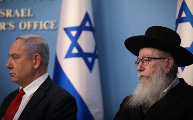 Israeli Prime Minister Benjamin Netanyahu and Health Minister Yaakov Litzman discuss coronavirus in Israel during a news conference at the Prime Ministers Office in Jerusalem on March 8, 2020. (Yonatan Sindel/Flash90/via JTA)