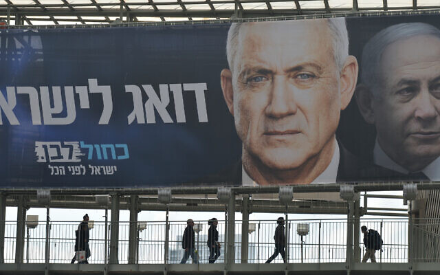 A campaign billboard in Ramat Gan, a suburb of Tel Aviv, featuring Blue and White party leader Benny Gantz in front of Israeli Prime Minister Benjamin Netanyahu. (Artur Widak/Getty Images/via JTA)