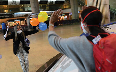 Israeli travelers enjoy a celebratory arrival late last month at Ben Gurion Airport. Tomer Neuberg/Flash90