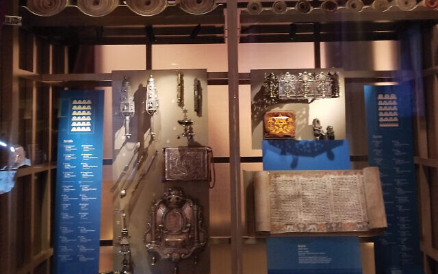 At the Museum of the Bible in Washington, D.C., unusable Torahs are rolled up like bolts of fabric on racks behind a glass wall. Photos by Hella Winston/JW